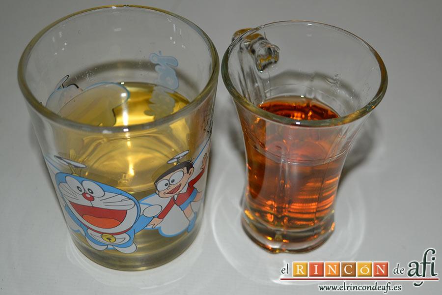 Chipirones afogaos, dejamos que rehogue unos minutos para añadirle el brandy y el vino blanco