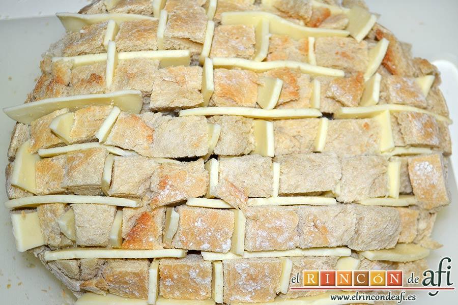 Pan erizo con queso y aceite de tomate y ajo, colocar luego queso en vertical