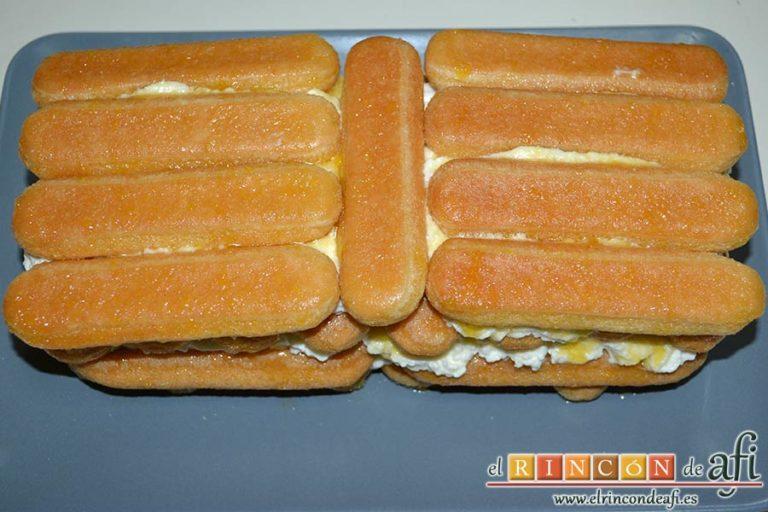 Tiramisú de frambuesas con almíbar de naranja, cubrir