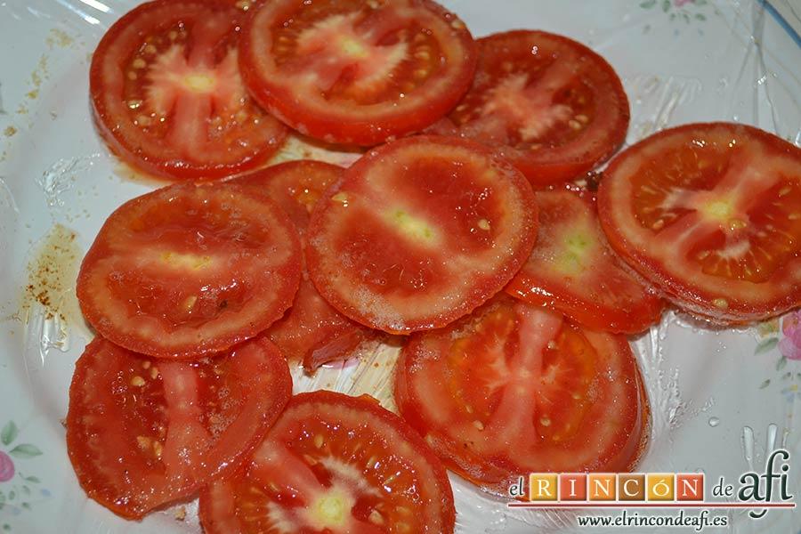 Berenjenas con tomates en rama, jamón y mozzarella, pasarlos a un plato
