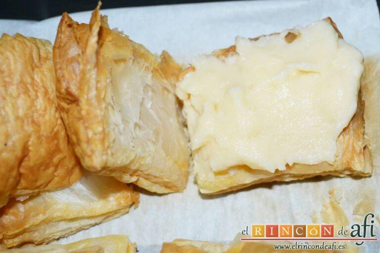 Miguelitos de la Roda, poner porciones de crema pastelera en cada hojaldre